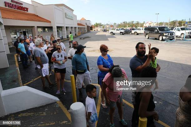 People wait in line outside of a hardware store two days after Hurricane Irma swept through the area on September 12 2017 in Fort Myers Florida...