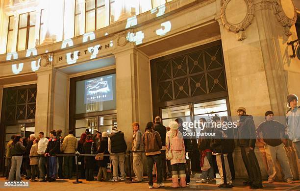 People wait in line outside of Nike Town in the lead up to the Nike Air Max Midnight Launch at Nike Town on January 21, 2006 in London, England. Nike...