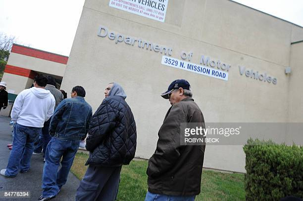 People wait in line outside of the State of California Department of Motor Vehicles in Los Angeles California on February 13 2009 The DMV already...