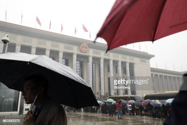 People wait in line outside the Great Hall of the People before the opening of the 19th National Congress of the Communist Party of China in Beijing,...
