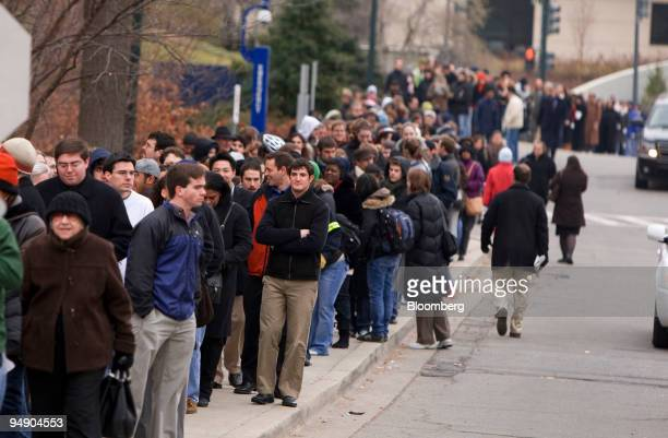 People wait in line to attend a campaign rally for Barack Obama US senator from Illinois and 2008 Democratic presidential candidate at American...