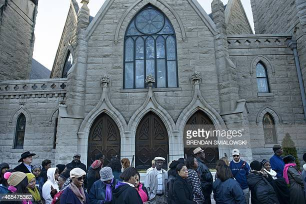 People wait in line to attend an anniversary event at the Edmund Pettus Bridge on March 7 2015 in Selma Alabama US President Barack Obama and the...