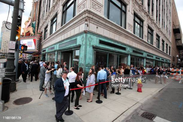 People wait in line to attend the Democratic Presidential Debate at the Fox Theatre July 30, 2019 in Detroit, Michigan. 20 Democratic presidential...