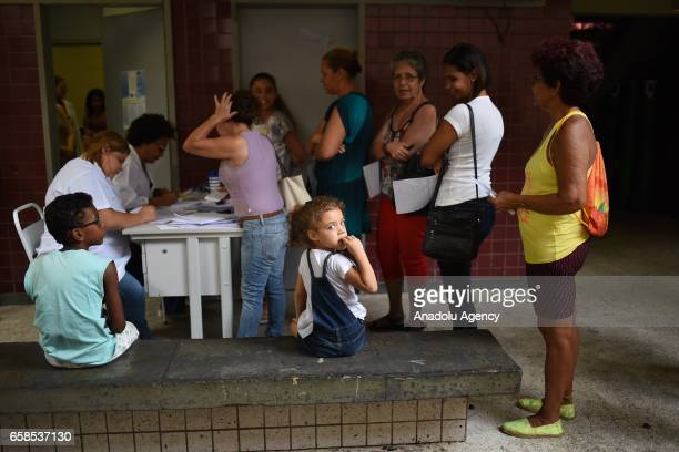 JANEIRO BRAZIL MARCH 27 People wait in line to be vaccinated against yellow fever in the health unit of the northern district of Andarai Rio de...