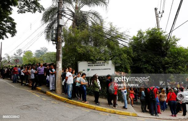 People wait in line to be vaccinated during a campaign of vaccination against yellow fever in Sao Paulo Brazil October 24 2017 Brazil is undergoing...
