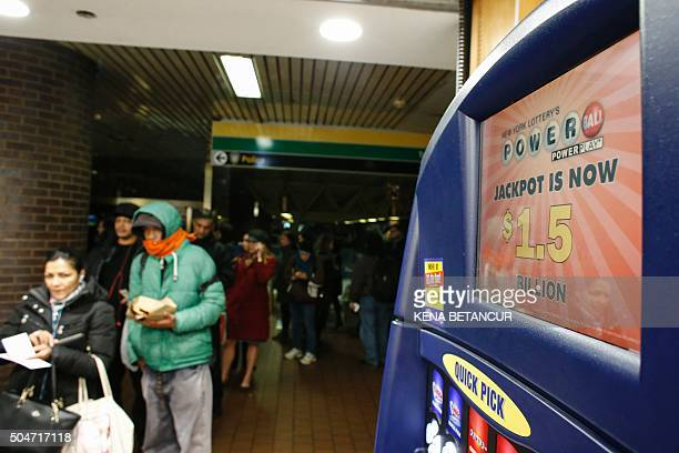 People wait in line to buy a Powerball lottery tickets at a newsstand in New York City on January 12 2016 Record sales drove up the largest jackpot...