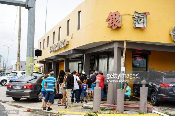 People wait in line to buy food at a restaurant after Hurricane Maria at PR167 in Bayamón Puerto Rico on September 21 2017