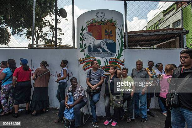 People wait in line to buy food in Caracas Venezuela on Saturday Feb 6 2016 Galloping inflation at an annual average of 983 percent last year...