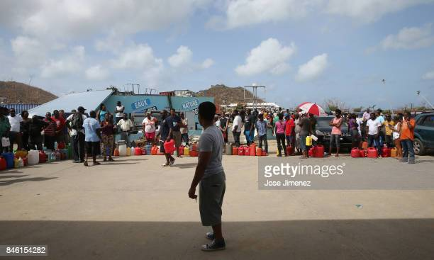 People wait in line to buy the permitted 20 Euros of gas days after this Caribbean island sustained extensive damage after the passing of Hurricane...