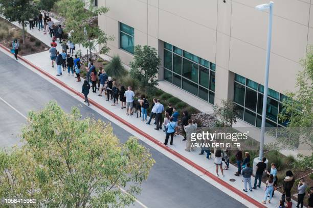 People wait in line to cast their ballot at a polling station on the San Diego Registrar's Office in San Diego California on November 6 on election...