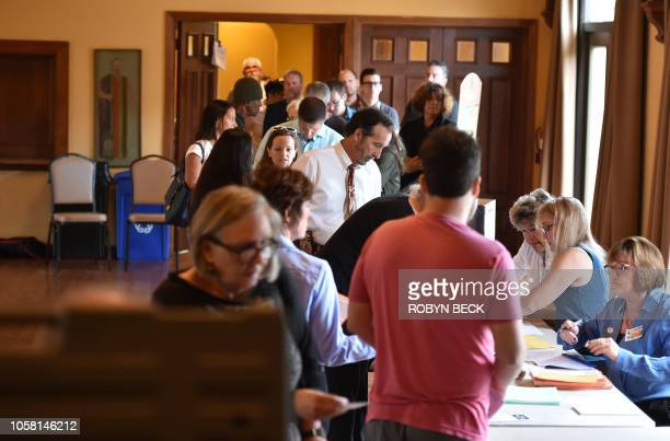 People wait in line to cast their ballot in the midterm elections at Neighborhood Congregational Church in Laguna Beach California on election day...