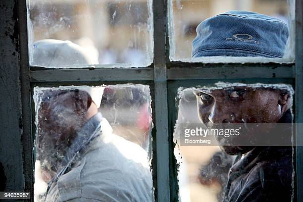 People wait in line to cast their ballots in Maseru, Lesotho, on Saturday, Feb. 17, 2007. Voters in the southern African kingdom began queuing at...