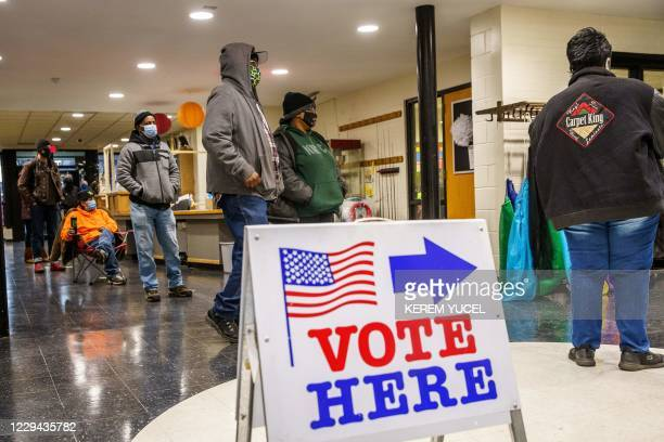 People wait in line to cast their ballots in Minneapolis, Minnesota on November 3, 2020. - The United States started voting Tuesday in an election...