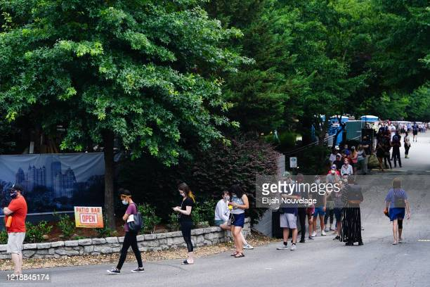People wait in line to cast votes in Georgia's Primary Election on June 9 2020 in Atlanta Georgia Georgia West Virginia South Carolina North Dakota...