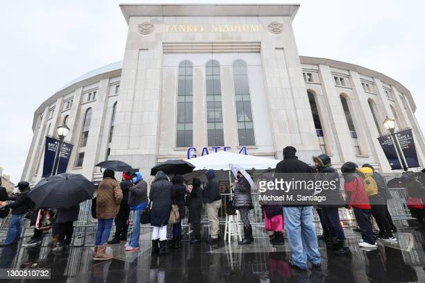 People wait in line to enter a coronavirus vaccination site at Yankee Stadium on February 05, 2021 in the Bronx borough of New York City. The...