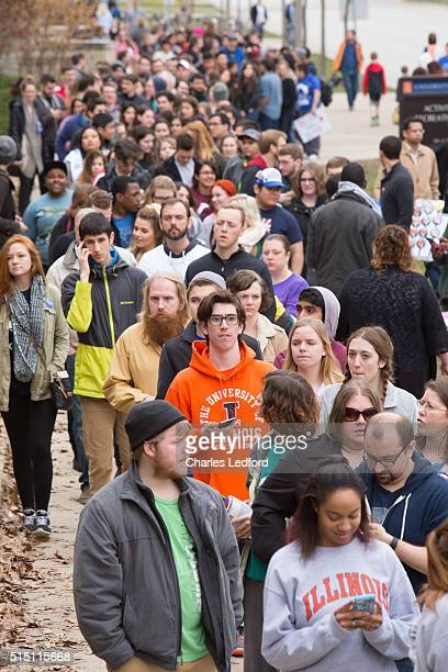 People wait in line to enter a rally for Democratic presidential candidate US Sen Bernie Sanders in the Activities and Recreation Center on the...