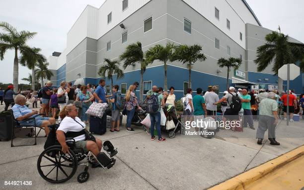 People wait in line to enter the Germain Arena that is serving as a shelter from the approaching Hurricane Irma on September 9 2017 in Estero Florida...