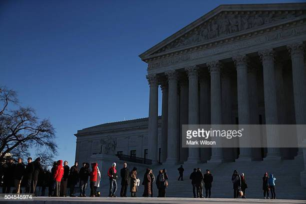 People wait in line to enter the US Supreme Court building January 11 2016 in Washington DC Today the high court is hearing arguments inÊthe...
