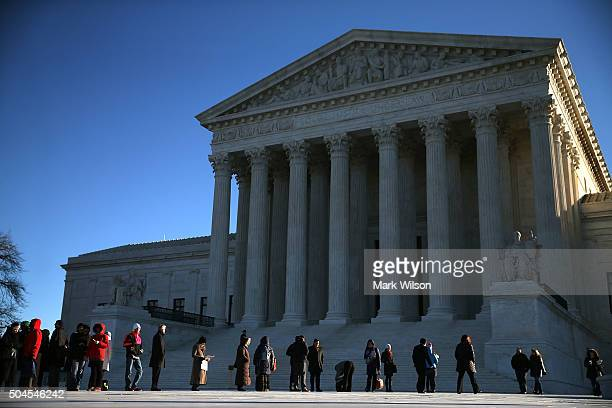 People wait in line to enter the US Supreme Court building January 11 2016 in Washington DC The high court is hearing arguments inÊthe Friedrichs v...