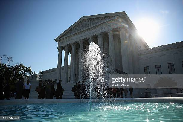 People wait in line to enter the US Supreme Court building June 20 2016 in Washington DC The high court still has four decisions to hand down before...