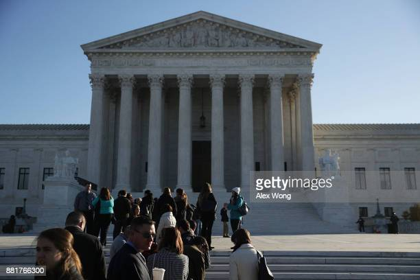 People wait in line to enter the US Supreme Court to view a hearing November 29 2017 in Washington DC The Supreme Court is scheduled to hear...