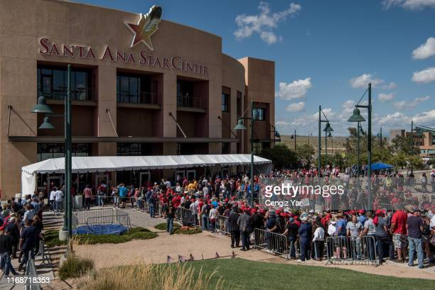 People wait in line to enter US President Donald J Trump's Keep America Great Rally on September 16 2019 at the Santa Ana Star Center in Rio Rancho...