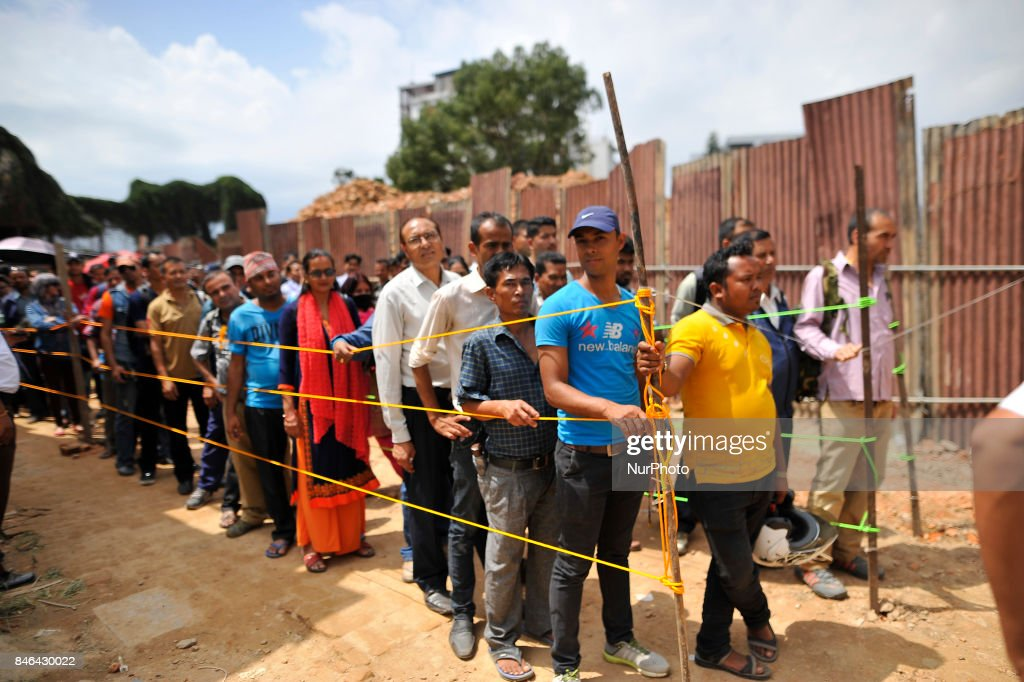 People wait in line to exchange new banknotes from a bank for the Biggest Dashain Festival in Kathmandu on Wednesday, September 13, 2017. The central bank said for general public can exchange as much as Rs 27,000 each from its Currency Management Division.