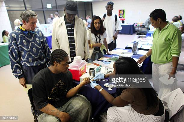 People wait in line to have their cholesterol checked by Jainine Vndoimen at the City of Newark's free homeless health fair at the Department of...
