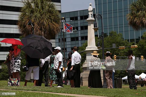 People wait in line to pay their respects before the coffin of church pastor and South Carolina State Sen Clementa Pinckney arrives to lie in the...