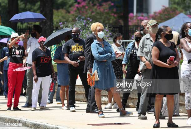 People wait in line to pay their respects to Rep. John Lewis as he lays in repose at the Georgia State Capitol on July 29, 2020 in Atlanta, Georgia....