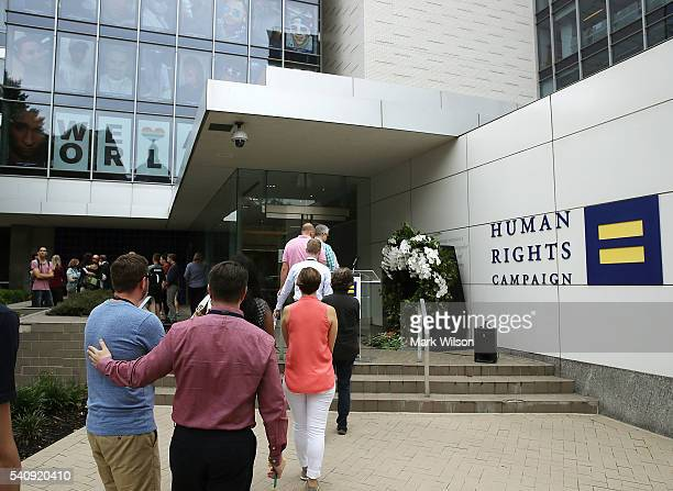 People wait in line to place a rose in front of a wreath at the Human Rights Campaign building, June 17, 2016 in Washington, DC. Images of the 49...