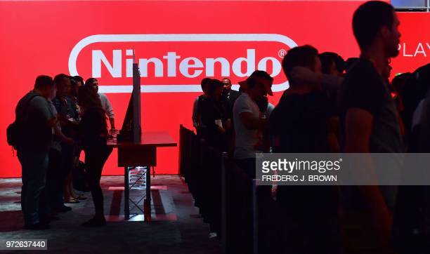 People wait in line to play Nintendo Switch games at the 24th Electronic Expo or E3 2018 in Los Angeles California on on June 12 where hardware...