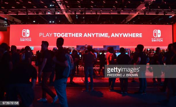 People wait in line to play Nintendo Switch games at the 24th Electronic Expo or E3 2018 in Los Angeles California on June 13 2018 where hardware...