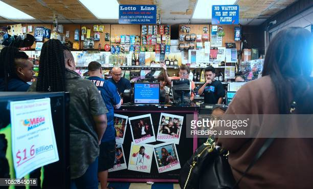 People wait in line to purchase lottery tickets at the Blue Bird Liquor store in Hawthorne California on October 23 2018 ahead of the drawing tonight...