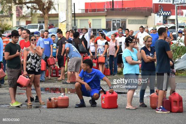 People wait in line to purchase petrol in Arecibo northwestern Puerto Rico on September 22 2017 in the aftermath of Hurricane Maria Puerto Rico...