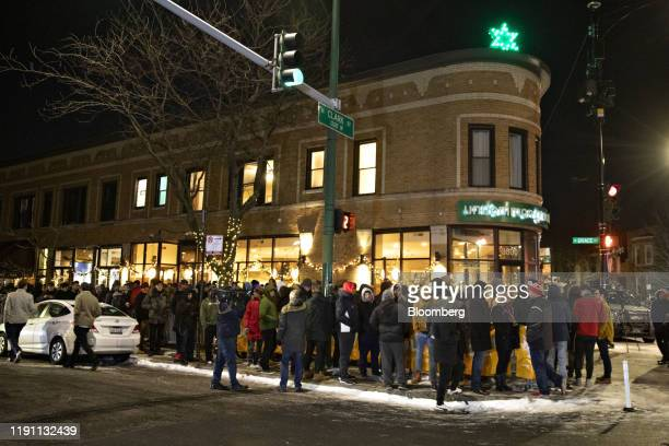People wait in line to purchase recreational marijuana outside the Cresco Labs Sunnyside* Lakeview dispensary in Chicago Illinois US on Wednesday Jan...