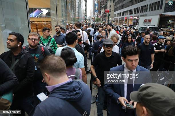 People wait in line to purchase the new iPhone XS and XS Max at the Apple store in Midtown Manhattan on September 21 2018 in New York City The two...