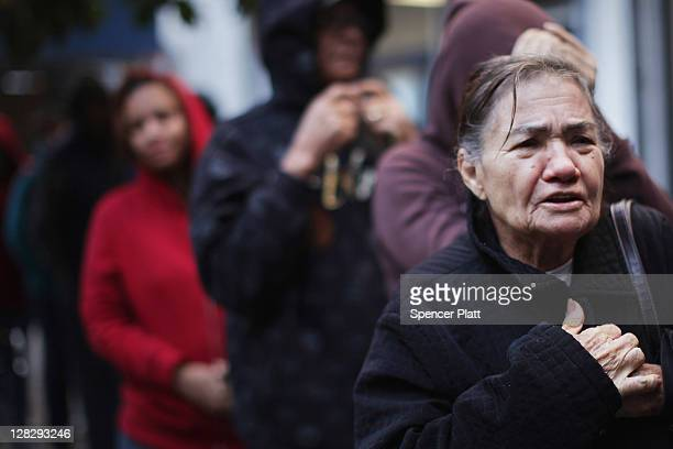People wait in line to receive free milk from the Milk from the Heart program which makes weekly deliveries to Washington Heights and 12 other...