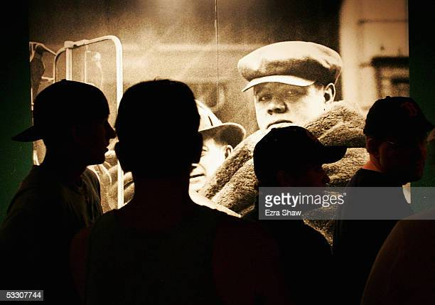 People wait in line to see a Babe Ruth exhibit in the National Baseball Hall of Fame and Museum on July 30, 2005 in Cooperstown, New York.