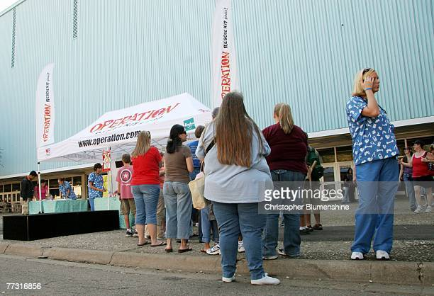 People wait in line to see actor Cody Linley at the Operation Rescue Kit game Mobile Rescue Unit booth at the State Fair of Texas at Fair Park on...