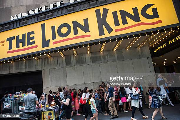 People wait in line to see the matinee show of The Lion King on May 27 2015 in New York City The Broadway season broke records with 131 million...