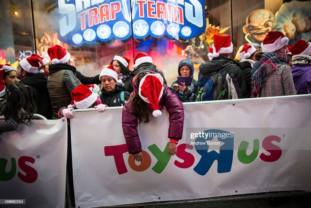 People wait in line to shop at the Toys R Us in Times Square on November 27, 2014 in New York, United States. Black Friday sales, which now begin on the Thursday of Thanksgiving, continue to draw shoppers out for deals and sales.