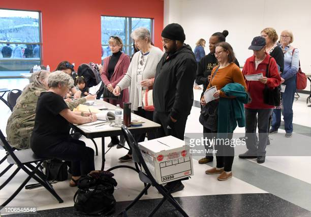 People wait in line to turn in their ballots as they vote on the first day of early voting for the upcoming Nevada Democratic presidential caucus at...