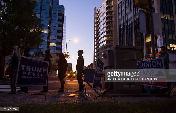 TOPSHOT People wait in line to vote at a poll station in Arlington Virginia on November 8 2016 With an anxious world watching Americans began voting...