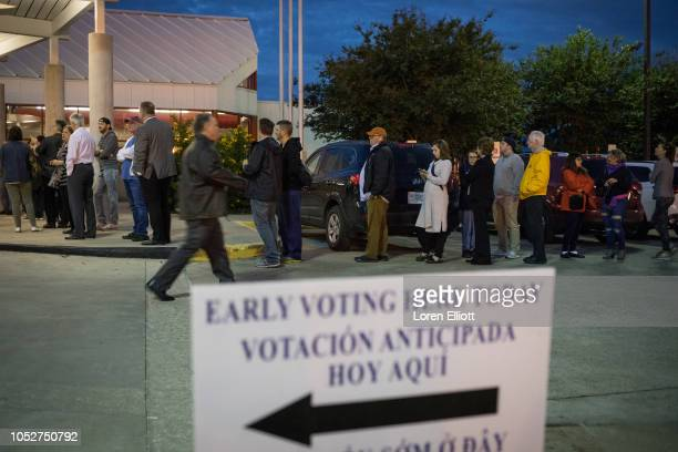 People wait in line to vote at a polling place on the first day of early voting on October 22 2018 in Houston Texas Democratic Senate candidate Rep...