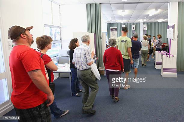 People wait in line to vote at Palm Beach Currumbin State High in the electorate of McPherson on election day on September 7 2013 in Gold Coast...