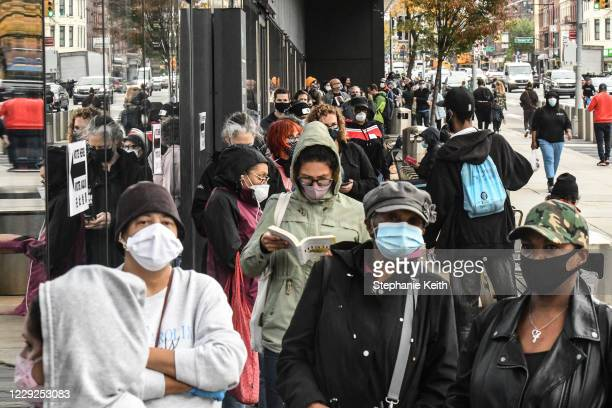 People wait in line to vote at the Barclays Center during early voting for the US Presidential election on October 24 2020 in the Brooklyn borough in...