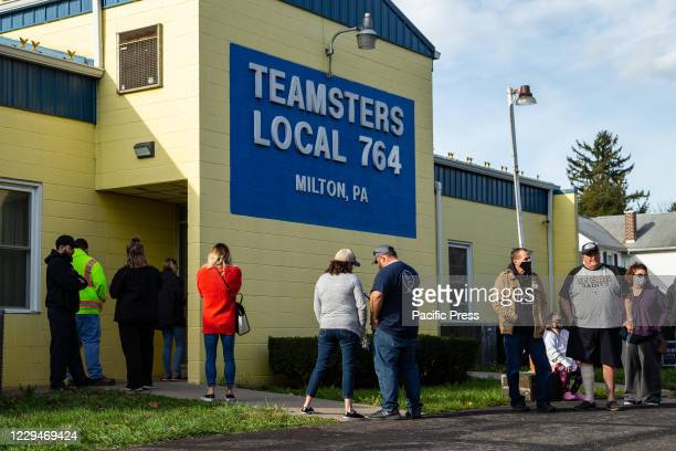 People wait in line to vote at the Fifth Ward polling place at Teamsters Local 764 in Milton.
