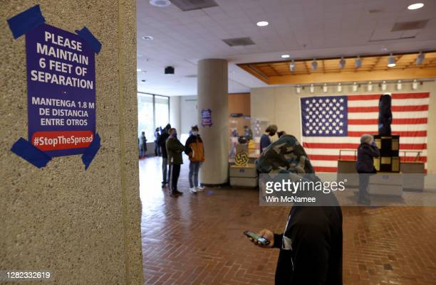 People wait in line to vote at the Montgomery County Executive Office Building on October 26 2020 in Rockville Maryland Today marks the first day of...