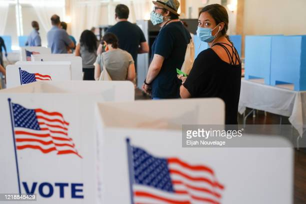 People wait in line to vote in Georgia's Primary Election on June 9 2020 in Atlanta Georgia Voters in Georgia West Virginia South Carolina North...